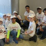 Cubotics take a moment to pose for a photo with their Mentors & Coaches.